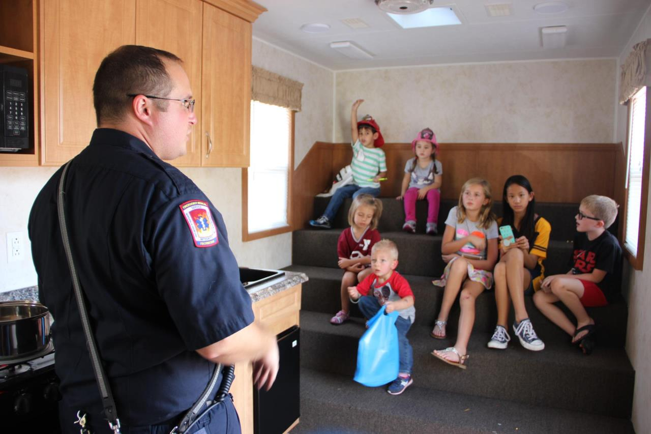 Eng. Jesse teaching children in fire safety house