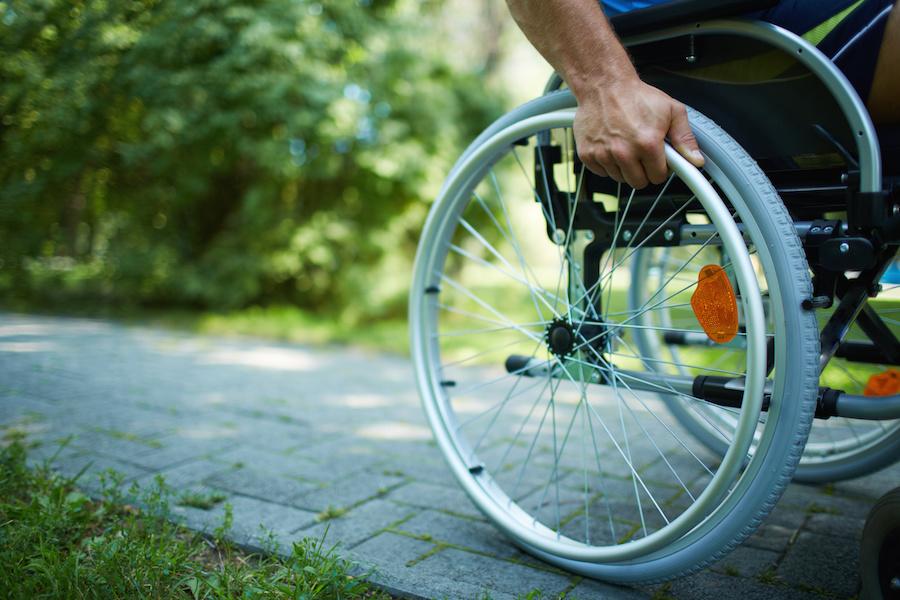 wheelchair going down sidewalk