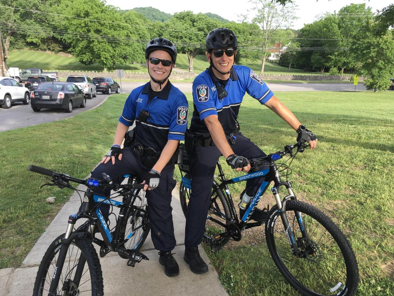 two police officers sitting on bicycles