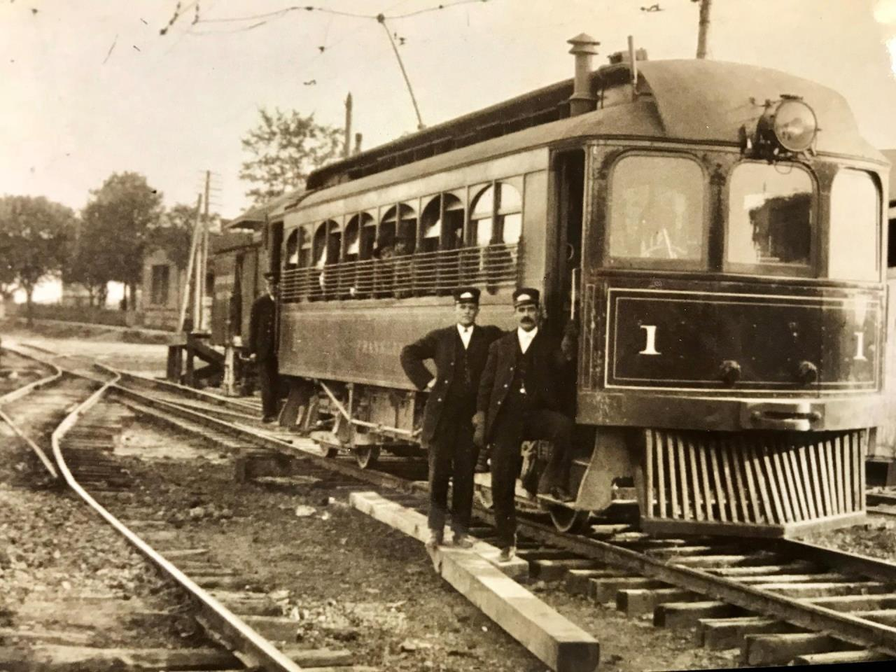 photo of old train and two men