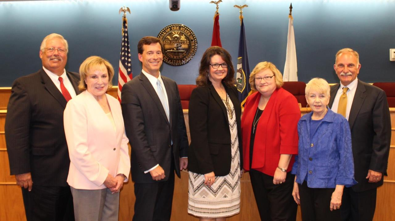 photo of seven Brentwood City Commissioners standing in City Hall