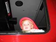 Child Sitting in Fire Engine